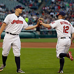 Cleveland Indians starting pitcher Justin Masterson, left, congratulates first baseman Mark Reynolds after Reynolds made a diving catch on a line drive by Kansas City Royals' Alex Gordon to  …