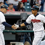 Cleveland Indians' Michael Brantley, right, is congratulated by third base coach Brad Mills after hitting a solo home run off Kansas City Royals starting pitcher Luis Mendoza in the fifth in …