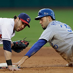 Kansas City Royals' Eric Hosmer, right, hangs on to second base after beating the tag of Cleveland Indians second baseman Jason Kipnis on a fifth-inning steal in a baseball game on Wednesday …