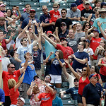 Fans vie for a free tee short between innings of a baseball game between the Tampa Bay Rays and Cleveland Indians Saturday, June 1, 2013, in Cleveland. (AP Photo/Mark Duncan)