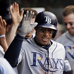 Tampa Bay Rays' Yunel Escobar is greeted in the dugout after a two run home run in the sixth inning of a baseball game against the Cleveland Indians Sunday, June 2, 2013, in Cleveland. (AP P …