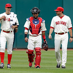Cleveland Indians starting pitcher Ubaldo Jimenez, left, walks in from the bellpen with catcher Carlos Santana and pitching coach Mickey Callaway, right, before a baseball game against the T …
