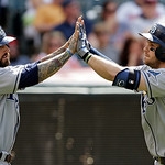 Tampa Bay Rays' Evan Longoria, right, celebrates his two-run home run with Ryan Roberts in the eighth inning of a baseball game against the Cleveland Indians Sunday, June 2, 2013, in Clevela …