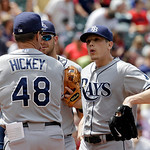 Tampa Bay Rays starting pitcher Jeremy Hellickson, right, gets a visit from pitching coach Jim Hickey (48) in the fourth inning of a baseball game Sunday, June 2, 2013, in Cleveland. (AP Pho …