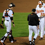 Baltimore Orioles starting pitcher Zach Britton (53) is pulled by manager Buck Showalter, center, against the Cleveland Indians during the sixth inning of a baseball game, Monday, June 24, 2 …