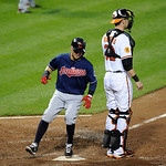 Cleveland Indians' Nick Swisher, left, steps on home plate against Baltimore Orioles catcher Matt Wieters, right, to score on a single by Michael Brantley during the sixth inning of a baseba …