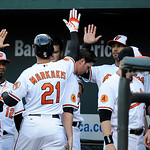 Baltimore Orioles' Nick Markakis (21) celebrates his home run against the Cleveland Indians with teammates in the dugout  during the first inning of a baseball game, Monday, June 24, 2013, i …