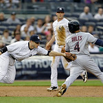 New York Yankees third baseman David Adams, left, tags out Cleveland Indians Mike Aviles (4) after catching him in a rundown after Nick Swisher hit into a third inning fielder's choice in a  …