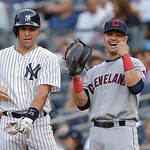 New York Yankees' Mark Teixeira, left, chats with Cleveland Indians first baseman Nick Swisher during a baseball game at Yankee Stadium in New York, Monday, June 3, 2013. It was the first ti …