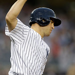 New York Yankees Mark Teixeira celebrates his third-inning grand slam in a baseball game at Yankee Stadium in New York, Monday, June 3, 2013.  (AP Photo/Kathy Willens)