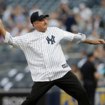 Big Ten Commissioner Jim Delany throws out the ceremonial first pitch before a baseball game between the New York Yankees and the Cleveland Indians at Yankee Stadium in New York, Monday, Jun …