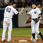 New York Yankees shortstop Reid Brignac (40) celebrates with the right fielder Ichiro Suzuki after the Yankees' 7-4 victory over the Cleveland Indians in a baseball game at Yankee Stadium in …
