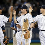 From left, New York Yankees' Robinson Cano, Mariano Rivera, Reid Brignac, and Mark Texeira celebrate the team's 7-4 victory over the Cleveland Indians in a baseball game at Yankee Stadium in …