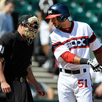 Chicago White Sox's Alex Rios argues with home plate umpire Quinn Wolcott left, after striking out during the ninth inning of a baseball game against the Cleveland Indians in Chicago, June 3 …