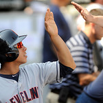 Cleveland Indians' Michael Brantley left, celebrates with teammates in the dugout after scoring on a ground rule double hit by Drew Stubbs during the ninth inning of an MLB baseball game aga …