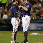 Cleveland Indians' Yan Gomes, left, talks with relief pitcher Bryan Shaw in the sixth inning of a baseball game against the Philadelphia Phillies, Wednesday, May 1, 2013, in Cleveland. (AP P …