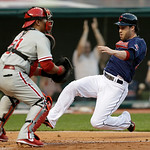 Cleveland Indians' Jason Kipnis, right, slides safely into home plate as Philadelphia Phillies catcher Carlos Ruiz waits for the ball in the third inning of a baseball game on Wednesday, May …