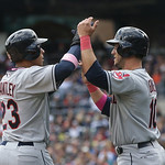 Cleveland Indians' Yan Gomes, right, and Michael Brantley score on teammate Jason Kipnis' two-run double off Detroit Tigers starting pitcher Rick Porcello during the third inning of a baseba …