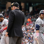 Cleveland Indians' Nick Swisher, right, looks back to home plate umpire Bill Miller after striking out during the sixth inning of an American League MLB  baseball game against the Detroit Ti …