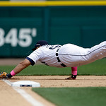 Detroit Tigers third baseman Miguel Cabrera stretches but misses a double by Cleveland Indians' Asdrubal Cabrera during the tenth inning of a baseball game in Detroit, Sunday, May 12, 2013.  …
