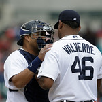 Detroit Tigers catcher Brayan Pena talks with relief pitcher Jose Valverde during the ninth inning of a baseball game in Detroit, Sunday, May 12, 2013. (AP Photo/Carlos Osorio)