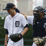 Detroit Tigers starting pitcher Rick Porcello, left, is patted on the head by catcher Brayan Pena after the Tigers pulled off a double play with the bases loaded during the fifth inning of a …