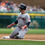 Cleveland Indians' Yan Gomes slides into third during the third inning of a baseball game against the Detroit Tigers in Detroit, Sunday, May 12, 2013. (AP Photo/Carlos Osorio)