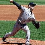New York Yankees relief pitcher David Phelps pitches in the first inning in the first baseball game of a doubleheader against the Cleveland Indians, Monday, May 13, 2013, in Cleveland. (AP P …