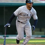 New York Yankees' Vernon Wells singles off Cleveland Indians pitcher David Huff in the ninth inning in the second baseball game of a doubleheader, Monday, May 13, 2013, in Cleveland. New Yor …