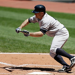 New York Yankees' Brett Gardner bunts in the sixth inning in the first baseball game of a doubleheader against the Cleveland Indians, Monday, May 13, 2013, in Cleveland. Gardner was safe at  …