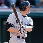 New York Yankees' Lyle Overbay hits a two-run single off Cleveland Indians relief pitcher Nick Hagadone in the seventh inning in the second baseball game of a doubleheader, Monday, May 13, 2 …
