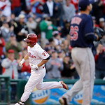 Philadelphia Phillies' Kevin Frandsen, left, rounds the bases after hitting a home run off Cleveland Indians starting pitcher Scott Kazmir in the first inning of a baseball game, Tuesday, Ma …