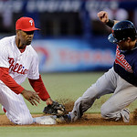 Cleveland Indians' Jason Kipnis, right, steals second base as Philadelphia Phillies shortstop Jimmy Rollins applies the tag in the third inning of a baseball game, Tuesday, May 14, 2013, in  …