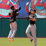 Miami Marlins shortstop Jose Reyes (7) leaps high to high five right fielder Giancarlo Stanton after beating the Cleveland Indians 5-3 in an interleague baseball game in Cleveland on Sunday, …