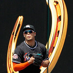 Miami Marlins right fielder Giancarlo Stanton looks back to the field after catching a long fly ball by Cleveland Indians' Johnny Damon in the seventh inning of an interleague baseball game  …