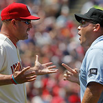 Cleveland Indians manager Manny Acta, left, argues a call with umpire Mark Carlson in the fifth inning of an interleague baseball game against the Miami Marlins in Cleveland, Sunday, May 20, …