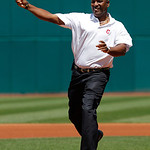 Former Cleveland Indians great Joe Carter throws out the ceremonial first pitch before the Indians face the Miami Marlins in an interleague baseball game in Cleveland, Sunday, May 20, 2012.  …