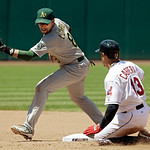 Cleveland Indians' Asdrubal Cabrera (13) slides into second with a double as Oakland Athletics shortstop Jed Lowrie takes the late throw in the fifth inning of a baseball game Thursday, May  …