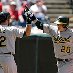 Oakland Athletics' Josh Donaldson (20) is welcomed home by Luke Montz (22) after a solo home run against the Cleveland Indians in the sixth inning of a baseball game Thursday, May 9, 2013, i …