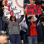 Cleveland Indians fans hold up signs in the eighth inning of a baseball game against the Chicago White Sox, Wednesday, Oct. 3, 2012, in Cleveland. The White Sox won 9-0. (AP Photo/Tony Dejak …