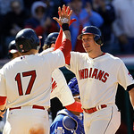 Cleveland Indians' Asdrubal Cabrera, right, is congratulated by Shin-Soo Choo after Cabrera hit a grand slam in the fifth inning of a baseball game against the Kansas City Royals, Sunday, Se …