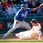 Kansas City Royals third baseman Tony Abreu, top, is late on the tag as Cleveland Indians' Jason Kipnis slides into third base in the seventh inning of a baseball game, Sunday, Sept. 30, 201 …