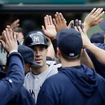 New York Yankees' Travis Hafner is congratulated by teammates after hitting a three-run home run off Cleveland Indians starting pitcher Ubaldo Jimenez in the first inning of a home opener ba …