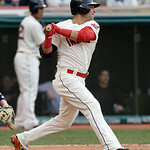 Cleveland Indians' Nick Swisher hits a single off New York Yankees starting pitcher Hiroki Kuroda during the first inning of a home opener baseball game, Monday, April 8, 2013, in Cleveland. …