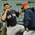 New York Yankees third baseman Kevin Youkilis, left, jokes with Cleveland Indians manager Terry Francona before a baseball game Monday, April 8, 2013, in Cleveland. (AP Photo/Mark Duncan)