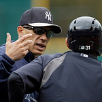 New York Yankees manager Joe Girardi talks with Ichiro Suzuki (31) during batting practice before a baseball game against the Cleveland Indians Monday, April 8, 2013, in Cleveland. (AP Photo …