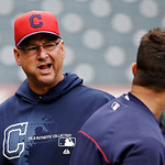 Cleveland Indians manager Terry Francona, left, talks with Nick Swisher before a baseball game against the New York Yankees Monday, April 8, 2013, in Cleveland. (AP Photo/Mark Duncan)