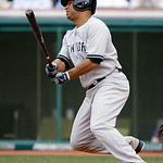 New York Yankees' Vernon Wells singles off Cleveland Indians relief pitcher Matt Albers in the fifth inning of a home opener baseball game, Monday, April 8, 2013, in Cleveland. (AP Photo/Mar …