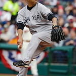 New York Yankees starting pitcher Hiroki Kuroda throws in the first inning of a home opener baseball game against the Cleveland Indians, Monday, April 8, 2013, in Cleveland. (AP Photo/Mark D …