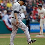 New York Yankees starting pitcher Hiroki Kuroda kicks the dirt after loading the bases in the first inning of a home opener baseball game against the Cleveland Indians, Monday, April 8, 2013 …